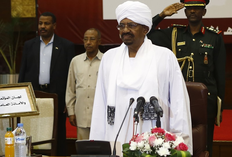 Sudanese President Omar al-Bashir (C) chairs the general assembly for the national dialogue on August 20, 2015 in the capital Khartoum. Bashir said he was ready for a two-month ceasefire with rebels in Sudan's border regions to allow national dialogue talks to take place to address the country's myriad problems, offering insurgents an amnesty. AFP PHOTO/ ASHRAF SHAZLY        (Photo credit should read ASHRAF SHAZLY/AFP/Getty Images)