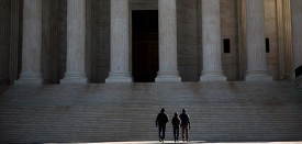 WASHINGTON, DC - FEBRUARY 14:  Visitors walk outside the U.S. Supreme Court following the death of Supreme Court Justice Antonin Scalia February 14, 2016 in Washington, DC. Supreme Court Justice Antonin Scalia was at a Texas Ranch Saturday morning when he died at the age of 79. (Photo by Drew Angerer/Getty Images)