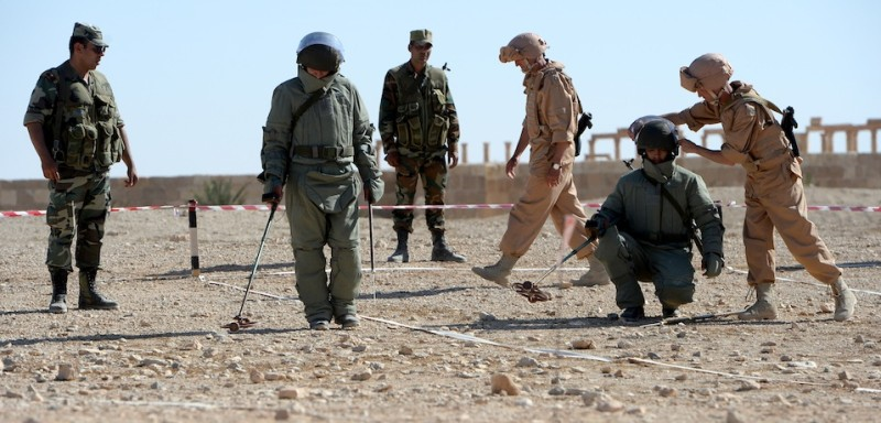 Russian army officers train Syrian army soldiers at their military camp known as the International Demining Center in the ancient Syrian city of Palmyra on May 5, 2016. / AFP / VASILY MAXIMOV        (Photo credit should read VASILY MAXIMOV/AFP/Getty Images)