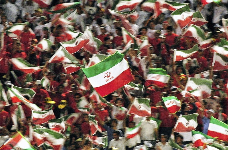 TEHRAN, IRAN - JUNE 8:  Iranian soccer fans gather for the Asian FIFA World Cup qualifying match between Iran and Bahrain at the Azadi Stadium on June 8, 2005 in Tehran, Iran. Iran won 1-0 and qualified for next year's World Cup in Germany. (Photo by Majid Saeedi/Getty images)