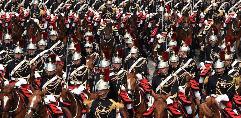 TOPSHOT - French troops of the Republican Guard on horseback take part in the annual Bastille Day military parade, on July 14, 2016.  France holds annual Bastille Day military parade with troops from Australia and New Zealand as special guests among the 3,000 soldiers who will march up the Champs Elysees avenue. They will be accompanied by 200 vehicles with 85 aircraft flying overhead. / AFP / DOMINIQUE FAGET        (Photo credit should read DOMINIQUE FAGET/AFP/Getty Images)