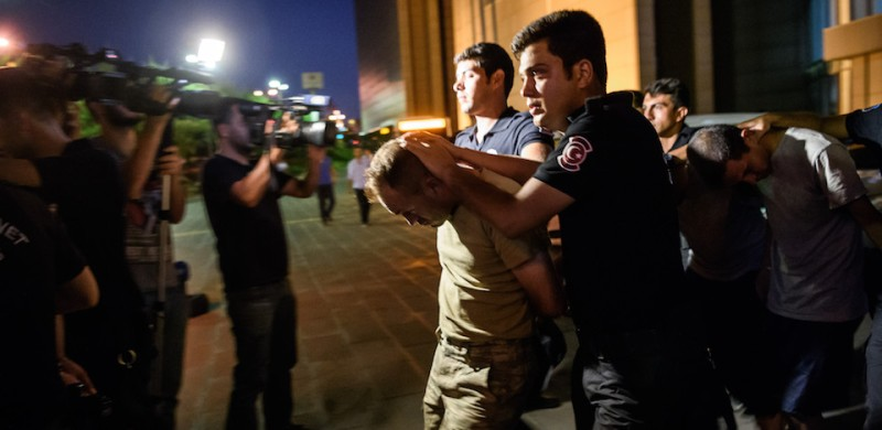 TOPSHOT - EDITORS NOTE: Graphic content / Turkish anti riot police officers escort Turkish soldiers who allegedly took part in a military coup as they are leaving the courthouse at Bakirkoy district in Istanbul on July 16, 2016.  President Recep Tayyip Erdogan battled to regain control over Turkey on July 16, 2016 after a coup that claimed more than 250 lives, bid by discontented soldiers, as signs grew that the most serious challenge to his 13 years of dominant rule was faltering. / AFP / OZAN KOSE        (Photo credit should read OZAN KOSE/AFP/Getty Images)