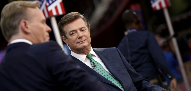 CLEVELAND, OH - JULY 17:  Paul Manafort (R), campaign manager for Republican presidential candidate Donald Trump, is interviewed by journalist John Dickerson (L) on the floor of the Republican National Convention at the Quicken Loans Arena  July 17, 2016 in Cleveland, Ohio. The Republican National Convention begins tomorrow.  (Photo by Win McNamee/Getty Images)