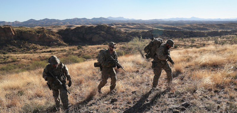 ARIVACA, AZ - NOVEMBER 14:  Civilian paramilitaries with Arizona Border Recon search for a illegal immigrants and drug smugglers at the U.S.-Mexico border on November 14, 2016 near Arivaca, Arizona. The armed group, made up mostly of former U.S. military servicemen and women, stages reconnaissance and surveillance operations against drug and human smuggling operations in remote border areas. The group, which claims up to 200 volunteers, does not consider itself a militia, but rather a group of citizens supplimenting U.S. Border Patrol efforts to control illegal border activity. With the election of Donald Trump as President, border security issues are a top national issue for the incoming Administration.  (Photo by John Moore/Getty Images)