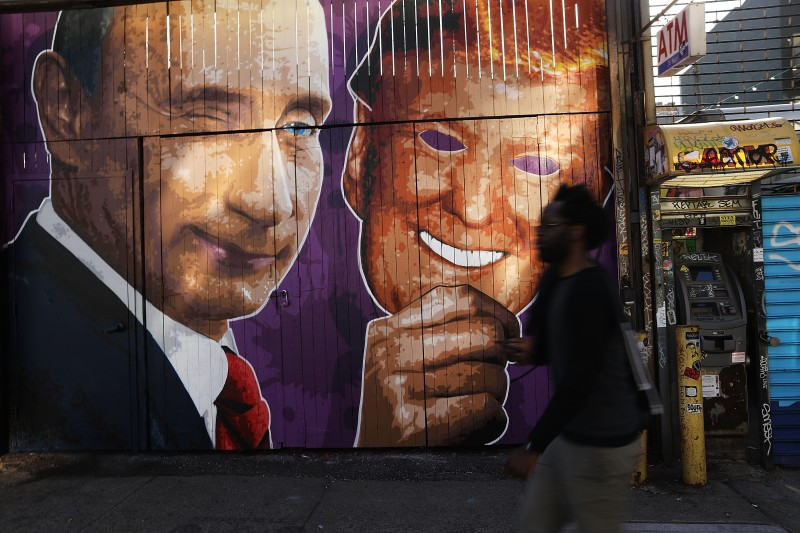NEW YORK, NY - FEBRUARY 25: A mural depicting a winking Vladimir Putin taking off his Donald Trump mask is painted on a storefront outside of the Levee bar in Brooklyn on February 25, 2017 in New York City. The mural, painted by Damien Mitchell, sits in the popular Williamsburg neighborhood and has become a minor attraction with people photographing and taking selfies beside it. (Photo by Spencer Platt/Getty Images)