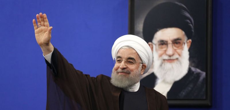 "Newly re-elected Iranian President Hassan Rouhani gestures after delivering a televised speech in the capital Tehran on May 20, 2017. A portrait of Iran's Supreme Leader Ayatollah Ali Khamenei is seen in the background. Iranians have chosen the ""path of engagement with the world"" and rejected extremism, President Hassan Rouhani said following his resounding re-election victory. / AFP PHOTO / ATTA KENARE        (Photo credit should read ATTA KENARE/AFP/Getty Images)"