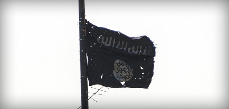 A picture taken on July 1, 2017, shows the black flag of the Islamic State (IS) group moving in the wind near the medical complex in the Shifa neighbourhood, on the west bank of Mosul, on July 1, 2017, where they are battling some of the last members of the Islamic State (IS) jihadist group in the city. / AFP PHOTO / Fadel SENNA        (Photo credit should read FADEL SENNA/AFP/Getty Images)