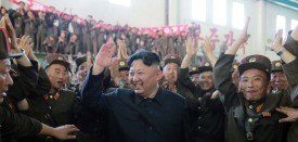 """This picture taken on July 4, 2017 and released from North Korea's official Korean Central News Agency (KCNA) on July 5, 2017 shows North Korean leader Kim Jong-Un (C) celebrating the successful test-fire of the intercontinental ballistic missile Hwasong-14 at an undisclosed location. South Korea and the United States fired off missiles on July 5 simulating a precision strike against North Korea's leadership, in response to a landmark ICBM test described by Kim Jong-Un as a gift to """"American bastards"""". / AFP PHOTO / KCNA VIA KNS / STR / South Korea OUT / REPUBLIC OF KOREA OUT   ---EDITORS NOTE--- RESTRICTED TO EDITORIAL USE - MANDATORY CREDIT """"AFP PHOTO/KCNA VIA KNS"""" - NO MARKETING NO ADVERTISING CAMPAIGNS - DISTRIBUTED AS A SERVICE TO CLIENTS THIS PICTURE WAS MADE AVAILABLE BY A THIRD PARTY. AFP CAN NOT INDEPENDENTLY VERIFY THE AUTHENTICITY, LOCATION, DATE AND CONTENT OF THIS IMAGE. THIS PHOTO IS DISTRIBUTED EXACTLY AS RECEIVED BY AFP.    /         (Photo credit should read STR/AFP/Getty Images)"""