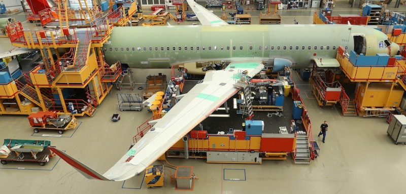 HAMBURG, GERMANY - JULY 14:  A partially-finished passenger plane of the A320 series stands in an assembly hall at the Airbus factory on July 14, 2017 in Hamburg, Germany. Both Boeing and Airbus saw their 2nd quarter deliveries of completed aircraft fall by 8% and 7% respectively compared to one year ago.  (Photo by Sean Gallup/Getty Images)