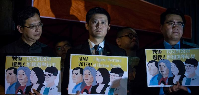 Pro-democracy lawmakers attend a rally in front of Civic Square in support of Nathan Law, Leung Kwok-hung, also known as 'long hair', Lau Siu-lai and Edward Yiu Chung-yim (not pictured) in Hong Kong on July 14, 2017, after a verdict was handed down invalidating their oaths, taken on October 12 last year.  Four pro-democracy lawmakers were disqualified from Hong Kong's parliament on July 14 in a move that will worsen growing fears the city's freedoms are under serious threat from Beijing. / AFP PHOTO / ISAAC LAWRENCE        (Photo credit should read ISAAC LAWRENCE/AFP/Getty Images)
