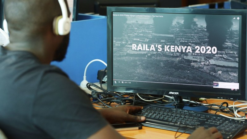 "A man watches a campaign ad that was unleashed on the internet this week in Kenya just weeks before national elections, on July 13, 2017, in Nairobi. The 90 second video, shot in moody monochrome, presented a dystopia in which Raila Odinga, Kenya's leading opposition candidate, won the August 8 vote and plunged the nation into a violent and inept dictatorship, setting tribes against one another while terrorists run riot. ""Stop Raila Save Kenya. The Future of Kenya is in Your Hands,"" the video concluded. / AFP PHOTO / SIMON MAINA        (Photo credit should read SIMON MAINA/AFP/Getty Images)"