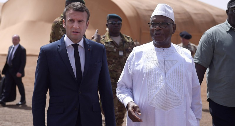 French President Emmanuel Macron (L) talks with Mali's President Ibrahim Boubacar Keita during a visit to the troops of France's Barkhane counter-terrorism operation in Africa's Sahel region in Gao, northern Mali, on May 19, 2017.  The French president's visit in Mali is his first trip outside Europe since his inauguration on May 14, 2017. / AFP PHOTO / POOL / CHRISTOPHE PETIT TESSON        (Photo credit should read CHRISTOPHE PETIT TESSON/AFP/Getty Images)