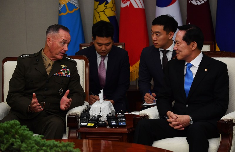 SEOUL, SOUTH KOREA - AUGUST 14:  U.S. Chairman of the Joint Chiefs of Staff Gen. Joseph Dunford (L) talks with South Korean Defence Minister Song Young-moo (R) during their meeting at the Defence Ministry on August 14, 2017 in Seoul, South Korea. Dunford is in South Korea to discuss the North Korean nuclear and missile threats with South Korea's defense minister and the military chief.  (Photo by Song Kyung-Seok-Pool/Getty Images)