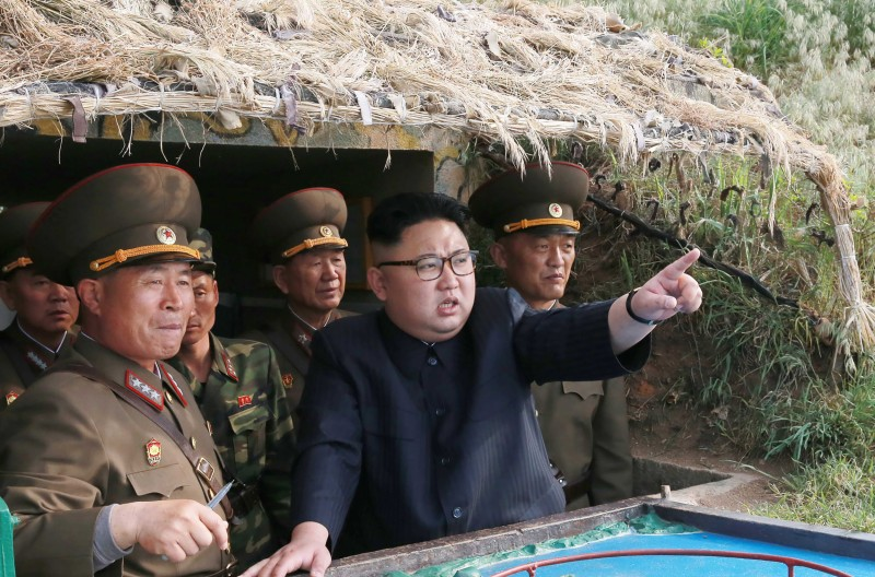 "This undated picture released from North Korea's official Korean Central News Agency (KCNA) on May 5, 2017 shows North Korean leader Kim Jong-Un (C) inspecting the defence detachment on Jangjae Islet and the Hero Defence Detachment on Mu Islet located in the southernmost part of the waters off the southwest front. / AFP PHOTO / KCNA VIA KNS / STR / South Korea OUT / REPUBLIC OF KOREA OUT   ---EDITORS NOTE--- RESTRICTED TO EDITORIAL USE - MANDATORY CREDIT ""AFP PHOTO/KCNA VIA KNS"" - NO MARKETING NO ADVERTISING CAMPAIGNS - DISTRIBUTED AS A SERVICE TO CLIENTS THIS PICTURE WAS MADE AVAILABLE BY A THIRD PARTY. AFP CAN NOT INDEPENDENTLY VERIFY THE AUTHENTICITY, LOCATION, DATE AND CONTENT OF THIS IMAGE. THIS PHOTO IS DISTRIBUTED EXACTLY AS RECEIVED BY AFP.  /         (Photo credit should read STR/AFP/Getty Images)"