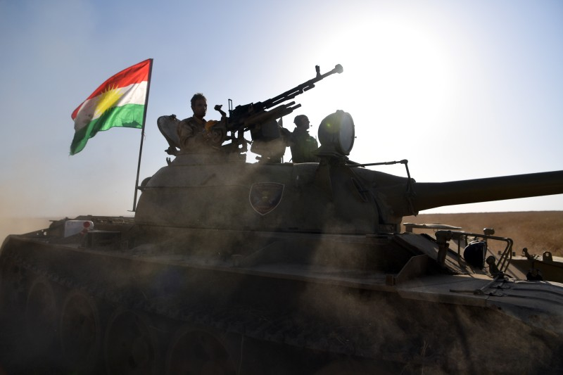 MOSUL, IRAQ - OCTOBER 20:  A Kurdish peshmerga tank moves forward during an assault to recapture the village of Tiskharab on October 20, 2016 near Mosul, Iraq. Kurdish and Iraqi forces, supported by numerous countries including Britain and the USA, have continued their advance towards towards Iraq's second largest city of Mosul which has been held by Islamic State militants since 2014.  (Photo by Carl Court/Getty Images)