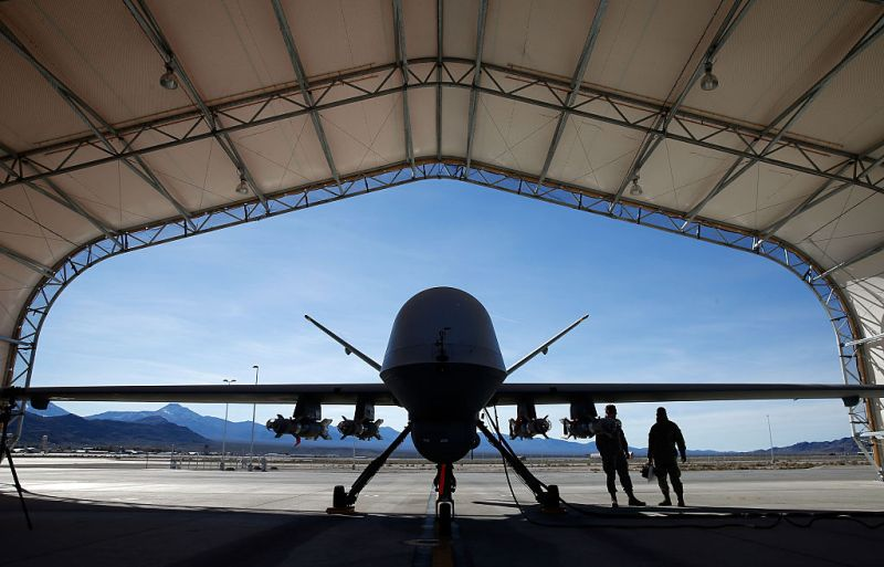 INDIAN SPRINGS, NV - NOVEMBER 17:  (EDITORS NOTE: Image has been reviewed by the U.S. Military prior to transmission.) An MQ-9 Reaper remotely piloted aircraft (RPA) is prepared for a training mission at Creech Air Force Base on November 17, 2015 in Indian Springs, Nevada. The Pentagon has plans to expand combat air patrols flights by remotely piloted aircraft by as much as 50 percent over the next few years to meet an increased need for surveillance, reconnaissance and lethal airstrikes in more areas around the world.  (Photo by Isaac Brekken/Getty Images)