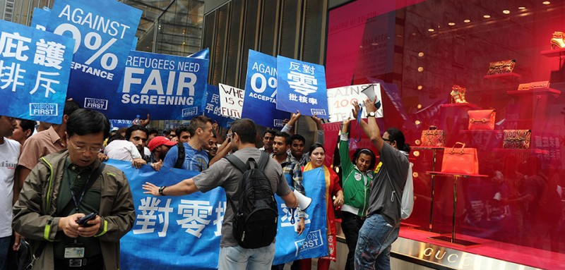 Protesters march during a demonstration by asylum seekers in Hong Kong on April 27, 2013.