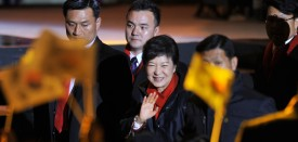South Korea's president-elect Park Geun-Hye waves to supporters as she arrives to deliver a victory speech on a stage in the centre of Seoul on December 19, 2012.   South Korea elected its first female president on December 19, handing a slim but historic victory to conservative ruling party candidate Park Geun-Hye, daughter of the country's former military ruler.  AFP PHOTO / JUNG YEON-JE        (Photo credit should read JUNG YEON-JE/AFP/Getty Images)