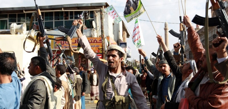 Tribal gunmen loyal to the Huthi movement brandish their weapons in the capital Sanaa on April 1, 2015, during a demonstration against Saudi-led coalitions Operation Decisive Storm against the Huthi rebels in Yemen. AFP PHOTO / MOHAMMED HUWAIS        (Photo credit should read MOHAMMED HUWAIS/AFP/Getty Images)