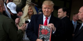 WINTERSET, IA - JANUARY 19:   Republican presidential candidate Donald Trump holds a copy of Time Magazine outside the John Wayne Birthplace Museum on January 19, 2016 in Winterset, Iowa. Trump received the endorsement of Aissa Wayne, John Wayne's daughter. (Photo by Aaron P. Bernstein/Getty Images)