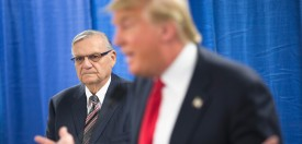 MARSHALLTOWN, IA - JANUARY 26:  Sheriff Joe Arpaio (L) of Maricopa County, Arizona listens as Republican presidential candidate Donald Trump speaks to the press prior to a rally on January 26, 2016 in Marshalltown, Iowa. Arpaio today announced his support for Trump's presidential bid.  (Photo by Scott Olson/Getty Images)