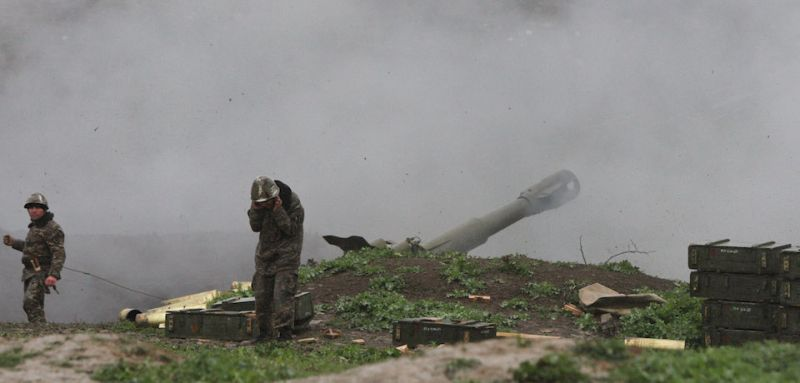 Armenian servicemen of the self-defense army of Nagorno-Karabakh fire an artillery shell towards Azeri forces from their positions in the town of Martakert in Armenian-seized Azerbaijani region of Nagorny Karabakh on April 3, 2016. Clashes between Azerbaijani and Armenian forces rumbled on April 3, despite Baku announcing a ceasefire after the worst outbreak of violence in decades over the disputed Nagorny Karabakh region sparked international pressure to stop fighting.  / AFP / PHOTOLURE / Vahram Baghdasaryan        (Photo credit should read VAHRAM BAGHDASARYAN/AFP/Getty Images)