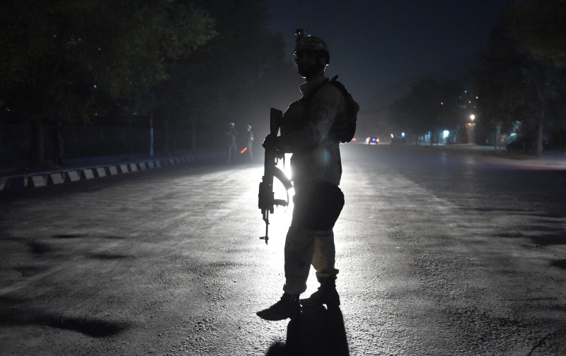 An Afghan security personnel walks as he keep watch near the site of an attack by gunmen inside the Kart-e- Sakhi shrine in Kabul on October 11, 2016. Gunmen targeted Shiite pilgrims in Kabul killing at least 14 people as they gathered to celebrate Ashura, one of the most important festivals on the Shiite calendar, officials said.The attack in the Afghan capital marked unravelling security as the resurgent Taliban continued to pressure Afghan forces, with hundreds of commandos sent to reinforce the provincial capital Lashkar Gah in the south.Some 36 people were wounded and at least one attacker killed in the Kabul attack, interior ministry spokesman Sediq Sediqqi said. / AFP / WAKIL KOHSAR        (Photo credit should read WAKIL KOHSAR/AFP/Getty Images)