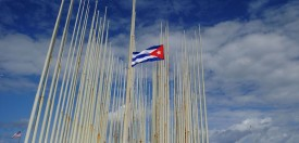 TOPSHOT - View of a Cuban flag at half-mast in front of the US Embassy in Havana, on November 26, 2016, the morning after Cuba's historic revolutionary leader Fidel Castro died aged 90. One of the world's longest-serving rulers and modern history's most singular characters, Castro defied 11 US administrations and hundreds of assassination attempts. / AFP / YAMIL LAGE        (Photo credit should read YAMIL LAGE/AFP/Getty Images)