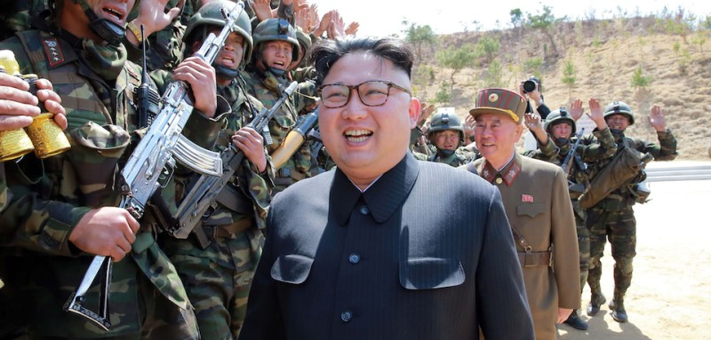 """TOPSHOT - This undated picture released from North Korea's official Korean Central News Agency (KCNA) on April 14, 2017 shows North Korean leader Kim Jong-Un (C) inspecting the """"Dropping and Target-striking Contest of KPA Special Operation Forces - 2017"""" at an undisclosed location in North Korea. North Korean leader Kim Jong-Un has overseen a special forces commando operation, state media said on April 13, as tensions soar with Washington over Pyongyang's nuclear programme. / AFP PHOTO / KCNA VIA KNS / STR / South Korea OUT / REPUBLIC OF KOREA OUT   ---EDITORS NOTE--- RESTRICTED TO EDITORIAL USE - MANDATORY CREDIT """"AFP PHOTO/KCNA VIA KNS"""" - NO MARKETING NO ADVERTISING CAMPAIGNS - DISTRIBUTED AS A SERVICE TO CLIENTS THIS PICTURE WAS MADE AVAILABLE BY A THIRD PARTY. AFP CAN NOT INDEPENDENTLY VERIFY THE AUTHENTICITY, LOCATION, DATE AND CONTENT OF THIS IMAGE. THIS PHOTO IS DISTRIBUTED EXACTLY AS RECEIVED BY AFP.  /         (Photo credit should read STR/AFP/Getty Images)"""