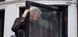 """Wikileaks founder Julian Assange leaves after speaking to the media from the balcony of the Embassy of Ecuador in London on May 19, 2017. WikiLeaks founder Julian Assange on Friday hailed an """"important victory"""" after Swedish prosecutors dropped a rape investigation against him, speaking in a rare public appearance at Ecuador's embassy in London. / AFP PHOTO / Justin TALLIS        (Photo credit should read JUSTIN TALLIS/AFP/Getty Images)"""
