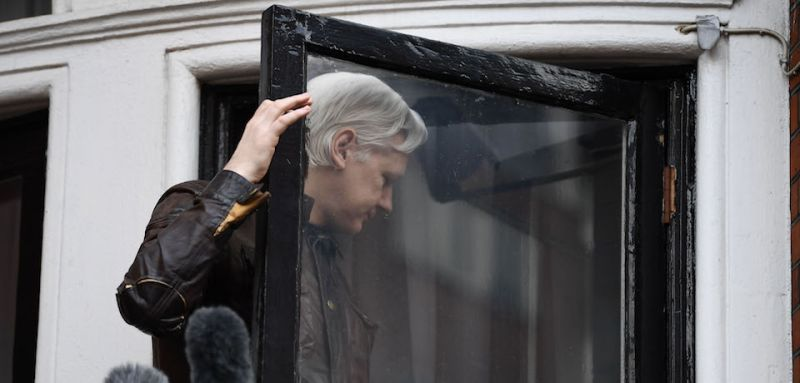 "Wikileaks founder Julian Assange leaves after speaking to the media from the balcony of the Embassy of Ecuador in London on May 19, 2017. WikiLeaks founder Julian Assange on Friday hailed an ""important victory"" after Swedish prosecutors dropped a rape investigation against him, speaking in a rare public appearance at Ecuador's embassy in London. / AFP PHOTO / Justin TALLIS        (Photo credit should read JUSTIN TALLIS/AFP/Getty Images)"