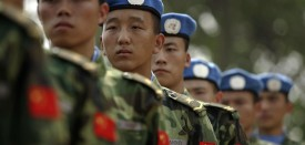 People's Liberation Army (PLA) soldiers deployed for United Nations (UN) peace keeping missions line up at their base in China's central Henan province before being sent to Africa, 15 September 2007. China will send a 315-member UN multi-functional engineering unit to the Dafur region of Sudan in October  to build and maintain barracks, roads, helipads and bridges.  AFP PHOTO/Peter PARKS (Photo credit should read PETER PARKS/AFP/Getty Images)