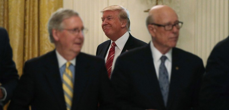 WASHINGTON, DC - JUNE 27:  U.S. President Donald Trump (C) arrives at the East Room of the White House as Senate Majority Leader Sen. Mitch McConnell (R-KY) (L) and Sen. Pat Roberts (R-KS) (R) wait for the beginning of a meeting June 27, 2017 in Washington, DC. President Trump invited all GOP Senate members to the White House to discuss the Health Care bill.  (Photo by Alex Wong/Getty Images)