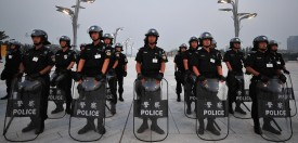 Members of a police SWAT team lineup outside the main Olympic Stadium, also known as the Bird's Nest, during security drill rehearsals on July 23, 2008 in Beijing. The 2008 Olympics' security chief has said that Beijing can stage a fun Olympics as well as a safe one, in response to charges that a massive security clampdown was squeezing the joy out of the Games. More than 110,000 troops and police were engaged in security and were joined by hundreds of thousands of volunteers and that millions of Beijing residents had also been roped into the operation. AFP PHOTO/Frederic J. BROWN (Photo credit should read FREDERIC J. BROWN/AFP/Getty Images)
