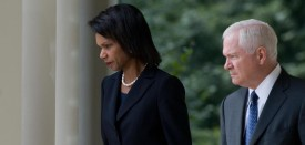 Secretary of State Condoleezza Rice (L) and Secretary of Defense Robert Gates (R) walk down the West Wing Colonnade prior to a statement by US President George W. Bush on the situation between Georgia and Russia in the Rose Garden of the White House in Washington, DC, on August 13, 2008. Russia must respect Georgia's territorial sovereignty, US President George W. Bush said Wednesday. AFP PHOTO/SAUL LOEB (Photo credit should read SAUL LOEB/AFP/Getty Images)