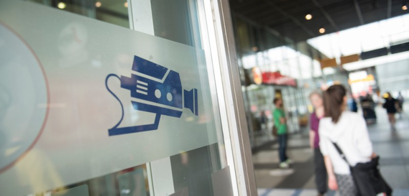 BERLIN, GERMANY - AUGUST 03: A sign  makes passersby aware of a facial recognition technology test at Berlin Suedkreuz station on August 3, 2017 in Berlin, Germany. The technology is claimed could track terror suspects and help prevent future attacks. (Photo by Steffi Loos/Getty Images)