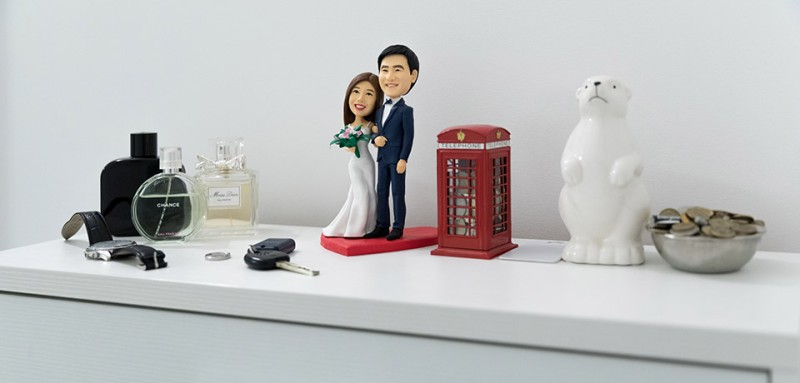 A wedding figurine of Qiudi Zhang and Askar Akhyltayev sits on a dresser at their home in Almaty, Kazakhstan.