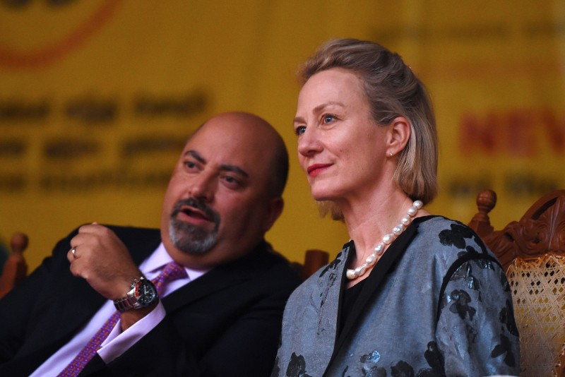 Acting Assistant Secretary of State for south and central Asian affairs Alice Wells, and Ambassador of the United States to Sri Lanka and the Maldives Atul Keshap (L) attend a candle light vigil for minority Tamils missing since the end of the island's drawn out Tamil separatist war in May 2009, in Sri Lanka's capital Colombo on August 30, 2017. / AFP PHOTO / ISHARA S. KODIKARA        (Photo credit should read ISHARA S. KODIKARA/AFP/Getty Images)