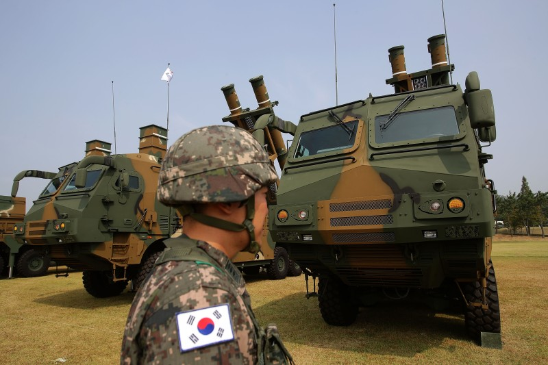 PYEONGTEAK, SOUTH KOREA - SEPTEMBER 25:  South Korean soldiers stand with Hyunmu-3 missile during the media day of the 65th South Korea Armed Forces Day ceremony on September 25, 2017 in Pyeongteak, South Korea. The anniversary ceremony is to mark that South Korean Army crossed the 38 parallel on October 1, 1950 during the Korean War.  (Photo by Chung Sung-Jun/Getty Images)