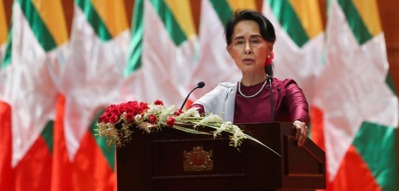 "TOPSHOT - Myanmar's State Counsellor Aung San Suu Kyi delivers a national address in Naypyidaw on September 19, 2017. Aung San Suu Kyi said on September 19 she ""feels deeply"" for the suffering of ""all people"" caught up in conflict scorching through Rakhine state, her first comments on a crisis that also mentioned Muslims displaced by violence. / AFP PHOTO / Ye Aung THU        (Photo credit should read YE AUNG THU/AFP/Getty Images)"