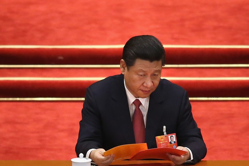 BEIJING, CHINA - MARCH 14:  China's newly-elected President Xi Jinping reads his ballot papers prior to the election for a new president of China during the fourth plenary meeting of the National People's Congress (NPC) at the Great Hall of the People on March 14, 2013 in Beijing, China. Xi Jinping, general secretary of the Communist Party of China Central Committee, was elected President of the People's Republic of China and Chairman of the Central Military Commission on Thursday.  (Photo by Feng Li/Getty Images)