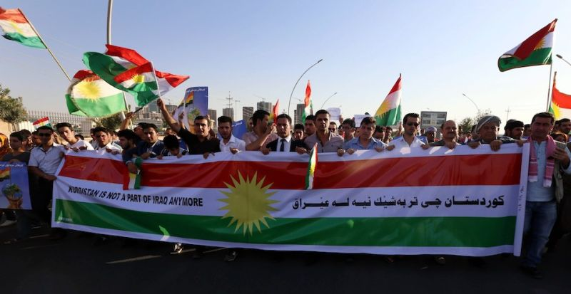 Iraqi Kurdish demonstrators wave the Kurdish flag during a protest demanding for the independence of Kurdistan outside the United Nations offices in Arbil, the capital of the autonomous Kurdish region, on August 23, 2014. About 700,000 Iraqis have gathered in the Kurdish north after being driven from their homes by jihadist Islamic State (IS) fighters, the UN said as it stepped up a massive aid operation to the region. AFP PHOTO / SAFIN HAMED        (Photo credit should read SAFIN HAMED/AFP/Getty Images)