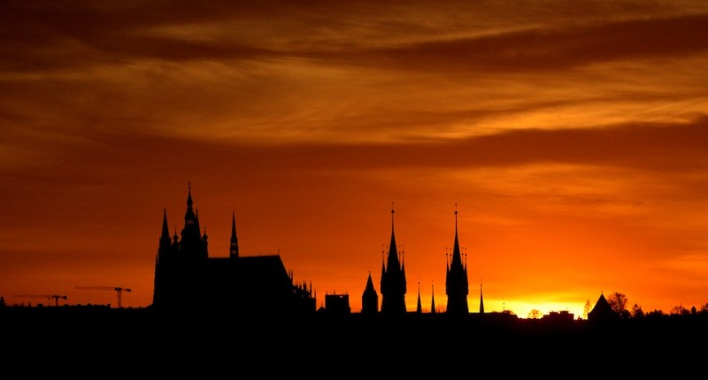The silhouette of Saint Vitus Cathedral (L), a part of the Prague Castle is seen on April 20, 2015 as the sun sets in the Czech capital. AFP PHOTO / MICHAL CIZEK        (Photo credit should read MICHAL CIZEK/AFP/Getty Images)