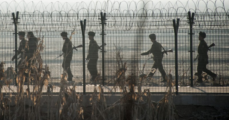 TOPSHOT - North Korean soldiers patrol next to the border fence near the town of Sinuiju across from the Chinese border town of Dandong on February 10, 2016.  North Korea has restarted a plutonium reactor that could fuel a nuclear bomb and is seeking missile technology that could threaten the United States, Washington's top spy said.   AFP PHOTO / JOHANNES EISELE / AFP PHOTO / JOHANNES EISELE        (Photo credit should read JOHANNES EISELE/AFP/Getty Images)