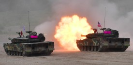 South Korea's K-1 tank fires during a joint military drill between US and South Korean Marines at a fire training field in the southeastern port of Pohang on July 6, 2016. South Korea and the United States are conducting a joint marine infiltration and attack exercise, testing the interoperability of the two countries' forces for a potential operation against North Korea. / AFP / JUNG YEON-JE        (Photo credit should read JUNG YEON-JE/AFP/Getty Images)