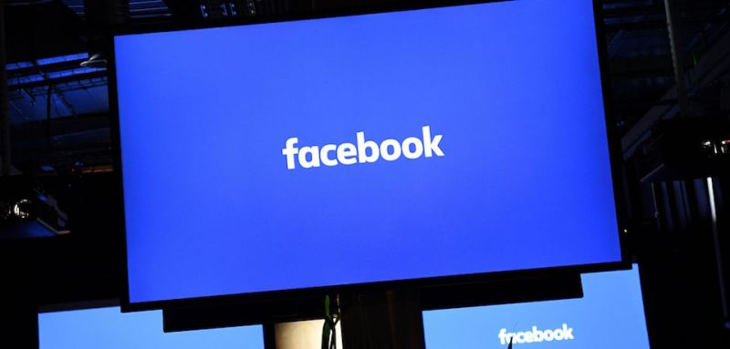 "A Facebook logo is pictured on a screen ahead of a press conference to announce the launch of it's latest product ""Workplace"", in central London on October 10, 2016. Social network giant Facebook launched new global product Workplace, a platform that it hopes will replace intranet, mailbox and other internal communication tools used by businesses worldwide. It is intended to compete with similar office communication products including Microsoft's Yammer, Salesforce's Chatter and Slack.  / AFP / Justin TALLIS        (Photo credit should read JUSTIN TALLIS/AFP/Getty Images)"