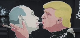 VILNIUS, LITHUANIA - NOVEMBER 23:  A mural depicts U.S. President-elect Donald Trump (R) blowing marijuana smoke into the mouth of Russian President Vladimir Putin on the wall of a bar-b-que restaurant on November 23, 2016 in Vilnius, Lithuania. Many people in the three Baltic nations of Lithuania, Latvia and Estonia are concerned that Russia, because Trump has expressed both admiration for Putin and doubt over defending NATO member states, will be emboldened to intervene militarily in the Baltics.  (Photo by Sean Gallup/Getty Images)