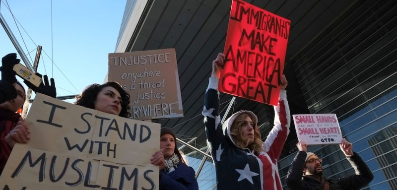 People hold up placards to protest against US President Donald Trump's executive order suspending the resettlement of refugees and banning people from seven majority-Muslim countries from entry into the US, during a rally near the US embassy in Tokyo on January 31, 2017. Some 40 foreigners living in Japan participated in the rally, as a defiant US President Trump struggled to defuse a mounting backlash over his ban on immigrants from seven Muslim-majority nations. / AFP / KAZUHIRO NOGI        (Photo credit should read KAZUHIRO NOGI/AFP/Getty Images)
