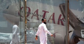 A picture taken on June 5, 2017 shows a man walking past the Qatar Airways branch in the Saudi capital Riyadh, after it had suspended all flights to Saudi Arabia following a severing of relations between major gulf states and gas-rich Qatar. Arab nations including Saudi Arabia and Egypt cut ties with Qatar accusing it of supporting extremism, in the biggest diplomatic crisis to hit the region in years. / AFP PHOTO / FAYEZ NURELDINE        (Photo credit should read FAYEZ NURELDINE/AFP/Getty Images)