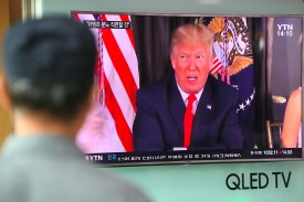 """A man watches a television news programme showing US President Donald Trump at a railway station in Seoul on August 9, 2017. President Donald Trump issued an apocalyptic warning to North Korea on Tuesday, saying it faces """"fire and fury"""" over its missile program, after US media reported Pyongyang has successfully miniaturized a nuclear warhead. / AFP PHOTO / JUNG Yeon-Je        (Photo credit should read JUNG YEON-JE/AFP/Getty Images)"""